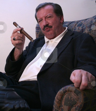 Walsh Attitude stock photo, Mike Walsh enjoys a cigar while relaxing in his Casper, WY apartment. by Clay Anthony