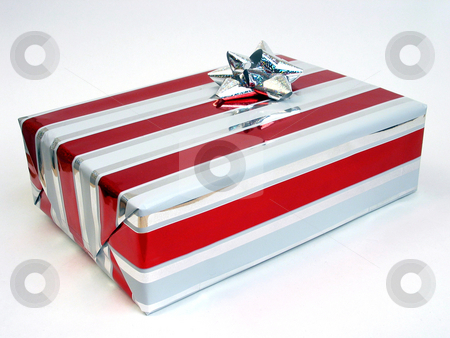 Xmas present stock photo, Christmas present wrapped with red, white and silver metalic paper and topped with silver metalic bow, all on white background. by Clay Anthony