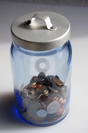 Change jar stock photo, Collection of coins in a savings jar by Heather Shelley