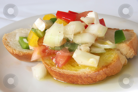 Bruschetta appetizer stock photo, Bruschetta traditional Italian appetizer with chopped vegetables on bread by Kheng Guan Toh