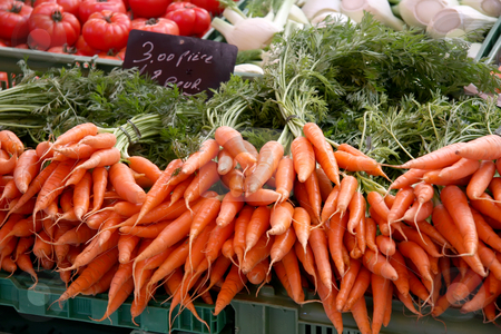 Fresh carrots stock photo, Fresh carrots with stalks for sale in market by Kheng Guan Toh