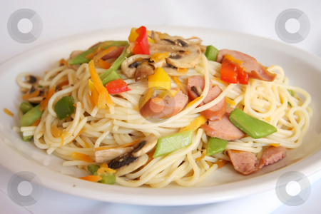 Fried noodles stock photo, Fried noodle pasta fusion cuisine with sausages and vegetables by Kheng Guan Toh