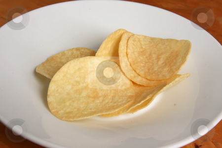 Potato chips stock photo, Fried potato chip snack food in white plate by Kheng Guan Toh