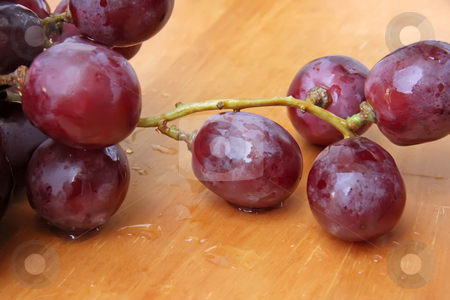 Red grapes stock photo, Bunch of red globe grapes fresh fruit by Kheng Guan Toh