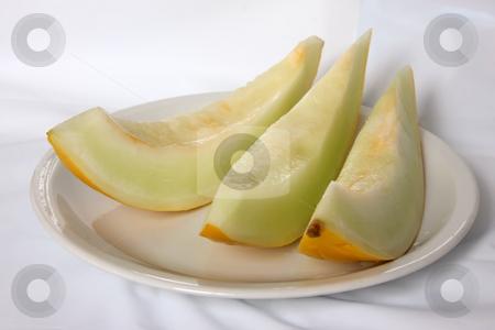 Yellow melon stock photo, Yellow melon cut in slices fresh fruit by Kheng Guan Toh