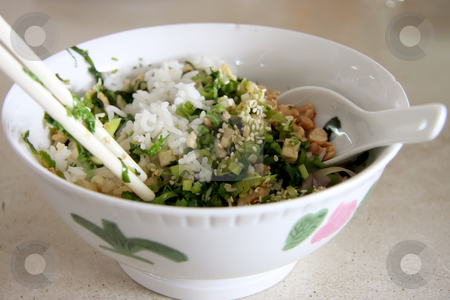 Chinese rice stock photo, Chinese rice dish with greens in bowl with chopsticks by Kheng Guan Toh