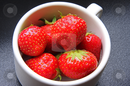 Fresh whole strawberries stock photo, Fresh whole strawberries with stem in white cup by Kheng Guan Toh