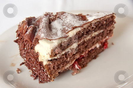 Black forest cake stock photo, Chocolate black forest cake slice on white plate by Kheng Guan Toh