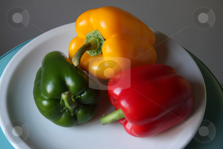 Capsicums stock photo, Several multicolored bell pepper capsicum vegetables on white plate by Kheng Guan Toh