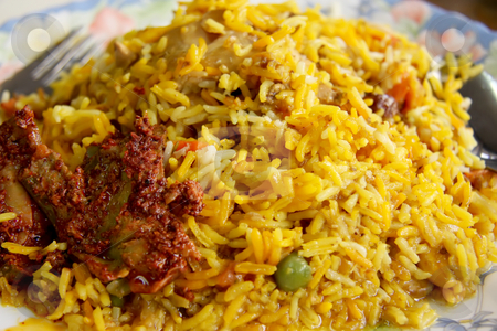 Spicy rice stock photo, Spicy indian rice with pickles by Kheng Guan Toh