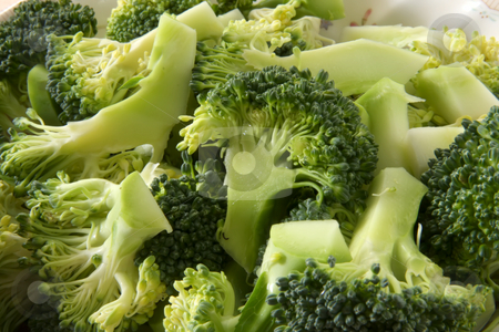 Broccoli pieces stock photo, Fresh raw sliced broccoli pieces closeup segments by Kheng Guan Toh
