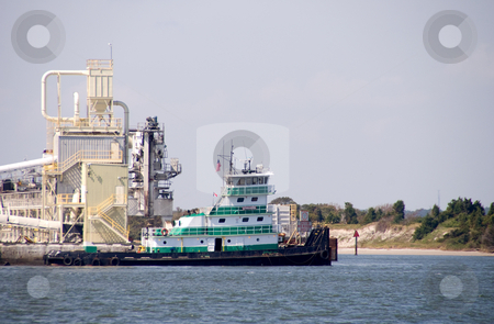 Tugboat stock photo, A tugboat docked at a seaside dock. by Robert Byron