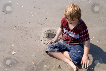 Boy Playing at the Ocean stock photo, A young boy playing at the ocean. by Robert Byron