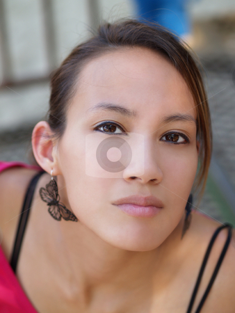 Woman portrait stock photo, Portrait of young asian american woman outdoors by Jeff Cleveland