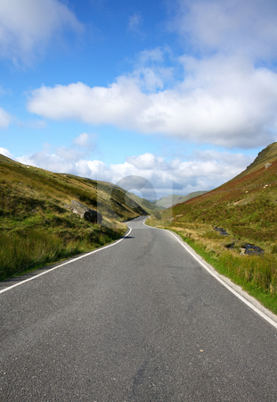 Narrow single lane country road in Wales UK. stock photo, Narrow single lane country road in Wales UK. by Stephen Rees