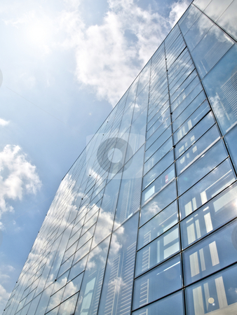 Blue offices building stock photo, Blue offices building with clouds reflection under the sun by Laurent Dambies