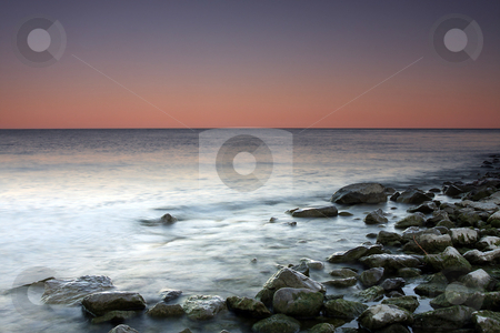 Sunset Hues stock photo, Beautiful Sunset over Lake Ontario using slow shutter speed. by Megan Lorenz