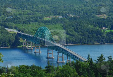 Suspension bridge stock photo, Suspension bridge over water by Will Burwell