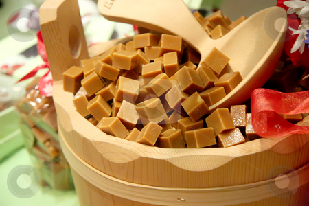 Caramel cubes stock photo, Caramel cubes in wooden bucket fancy confectionary presentation by Kheng Guan Toh