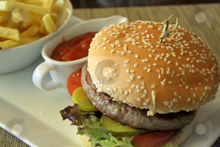 Fancy cheeseburger  stock photo, Fancy cheeseburger with french fries served in restaurant by Kheng Guan Toh