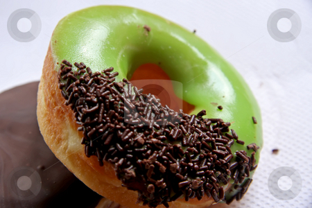 Glazed donuts stock photo, Whole glazed donut with chocolate sprinkles and green icing by Kheng Guan Toh