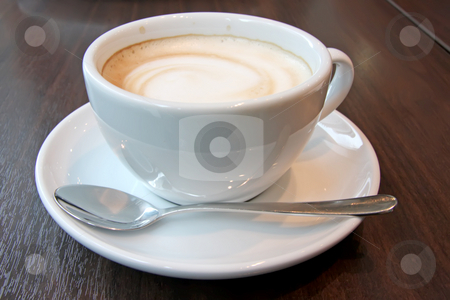 Coffee with foam stock photo, Coffee with foam swirl in round white mug by Kheng Guan Toh