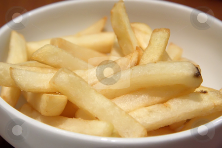 French fries stock photo, Bowl of french fried potatoes straight cut by Kheng Guan Toh