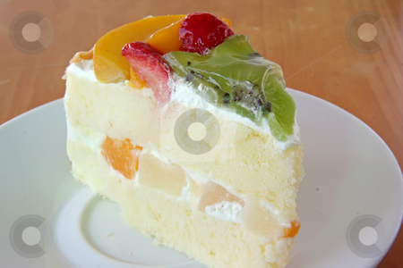 Cream cake stock photo, Cream chiffon cake with fruits and icing by Kheng Guan Toh