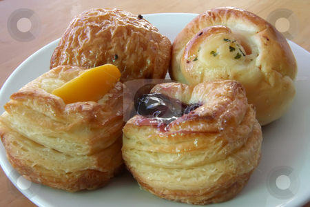 Assorted pastries stock photo, Assorted pastries baked breads on white plate by Kheng Guan Toh