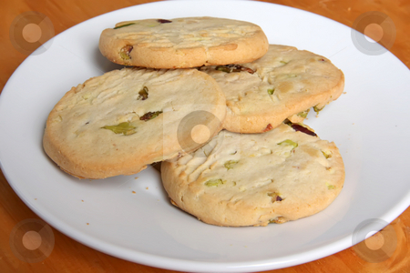 Pistachio cookies stock photo, Pistachio and cranberry cookies biscuits on plate by Kheng Guan Toh