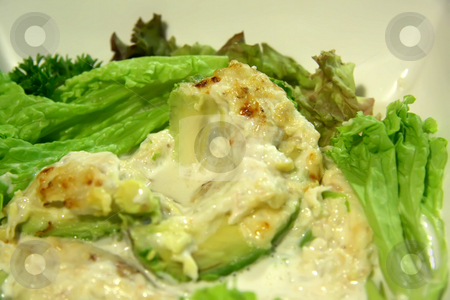 Avocado crab salad stock photo, Avocado and crab salad with leafy vegetables on white plate by Kheng Guan Toh