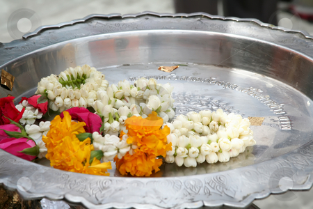 Silver Offering plate stock photo, Shrine offerings of flowers in a Thai Buddhist temple by Kheng Guan Toh