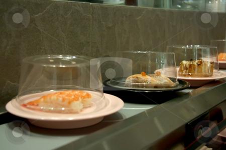 Conveyor belt sushi stock photo, Conveyor belt sushi traditional japanese dishes on rotating conveyance by Kheng Guan Toh