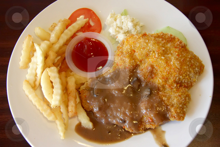 Breaded chicken chop stock photo, Breaded fried chicken chop with french fries and gravy by Kheng Guan Toh