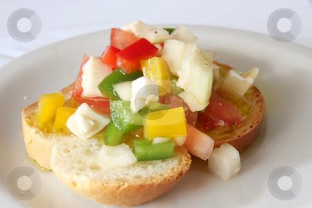 Bruschetta appetizer stock photo, Bruschetta traditional Italian appetizer with chopped vegetables on bread by Kheng Guan Toh