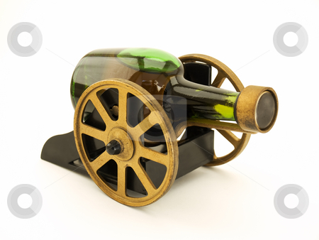 Alcoholic cannon stock photo, Bottle with alcohol drink like vintage cannon on a clear background. by Sinisa Botas
