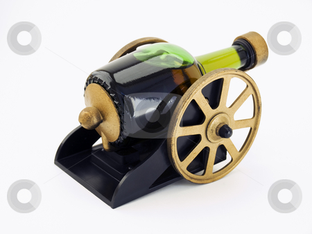 Drunk Cannon stock photo, Bottle with alcohol drink like vintage cannon on a clear background. by Sinisa Botas
