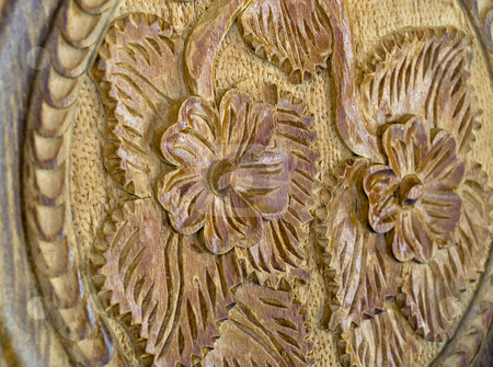 Engraved wooden flowers stock photo, Detail of woodcut with flowers motive in wood. by Sinisa Botas