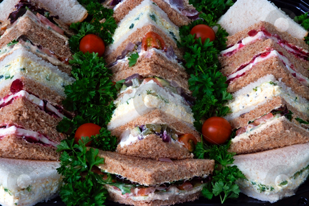Quick lunch stock photo, Sandwiches cut into triangles on a tray prepared for a business lunch by Paul Phillips
