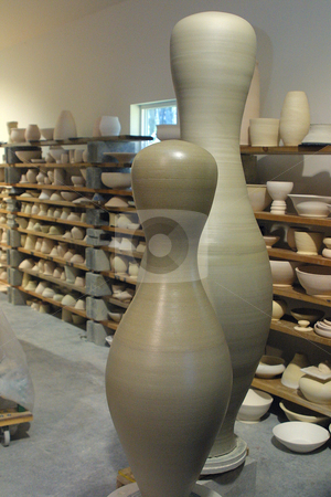 Ceramic Pottery Bowling Pins stock photo, October 9, 2003 : Ceramic Artist Brian Mackin creates large vase and bowling pin style pieces in his studio on Bainbridge Island, Washington.  Mackin is known for making giant ceramic pieces. by Jesse Beals