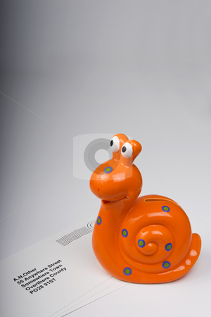 Snail Mail 5 stock photo, Orange snail carrying letters to destination. by Steve Smith