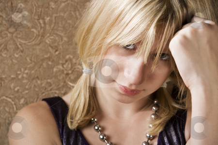 Pretty girl with hand on her head stock photo, Pretty young girl with hand on her head by Scott Griessel