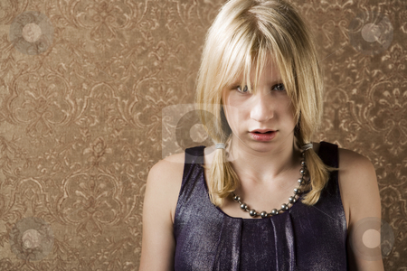 Pouting teenage girl stock photo, Pretty young girl with blonde hair pouting by Scott Griessel