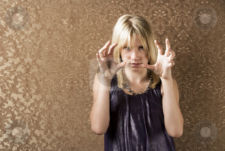 Pretty young girl showing frustration stock photo, Pretty young girl showing frustration and making a choking gesture by Scott Griessel