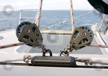 Reels for sails stock photo, Two reels that are used to adjust the front sails on a Catamaran with a view of the horizon and trampoline by Paul Hakimata
