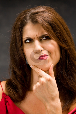 Thinking woman stock photo, The beautiful face of a thinking woman with hand on chin by Paul Hakimata