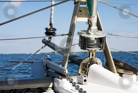 Bow of Catamaran stock photo, The bow of a Catamaran as seen from the ship itself focusing on the spools that control the front sails by Paul Hakimata