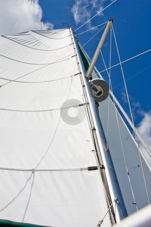 Mast and Sails stock photo, Mast and sails with radar and GPS standing tall with deep blue sky and white clouds by Paul Hakimata