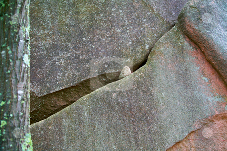 Diagonal lines in the stone stock photo, A small stone showing thru the crevase in the granite by Mitch Aunger
