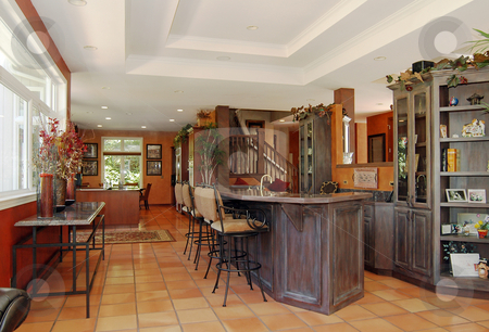 Bar stock photo, This bar breaks up the space between the family room and the kitchen in this long expanse in the home. by Tim Thompson